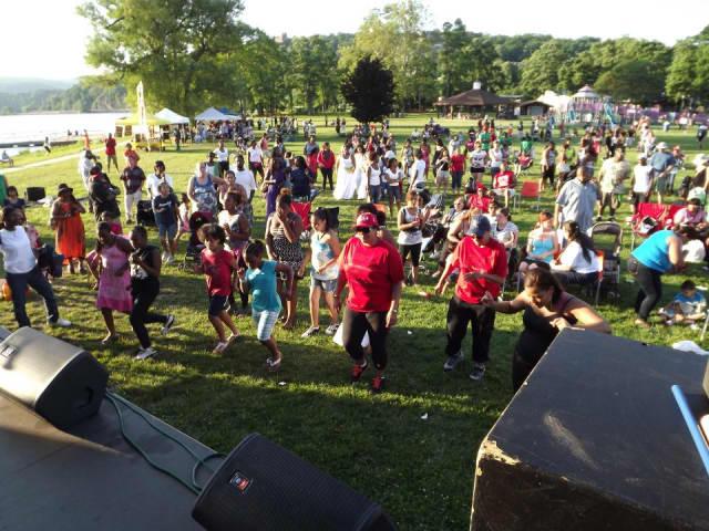 Residents enjoying a concert at a past Juneteenth celebration.