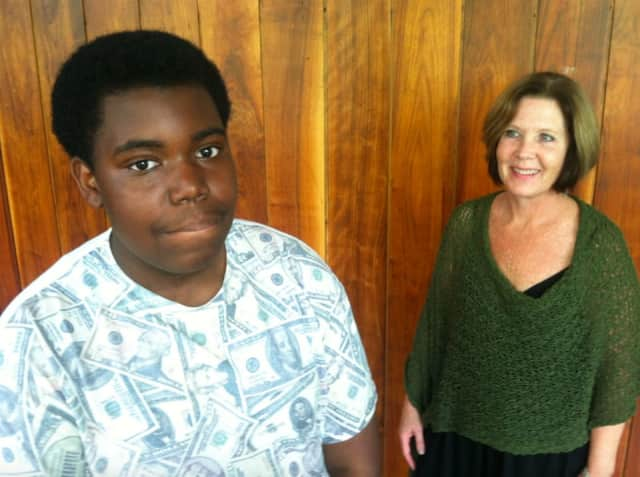 Grade 8 Rippowam student Derrick Charleus and teacher Deirdre Crouch.