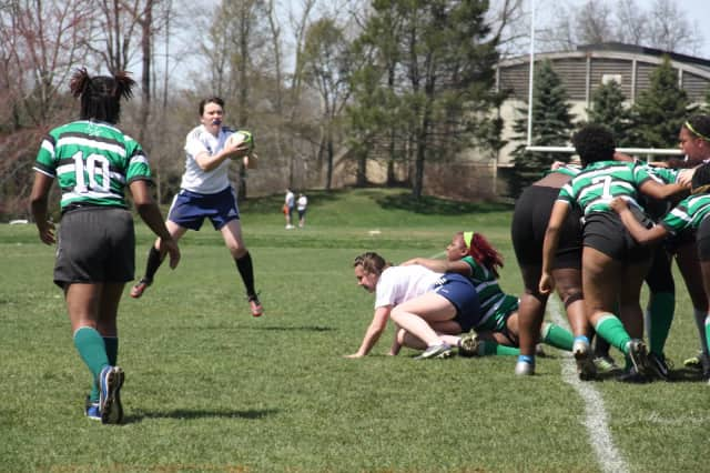 Julia Frisch, named to the NJ/NY Girls Rugby 15s All-Star Team, goes airborne in an attempt to score for Harvey against South Jersey in a game this season.