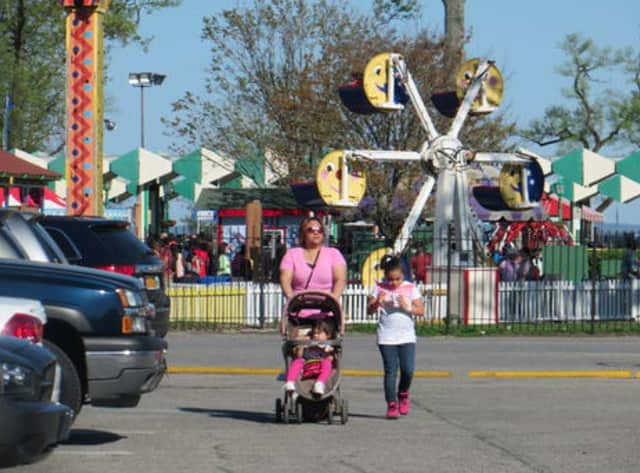 A mother and her two children leave Playland Amusement Park on opening weekend in May 2014.