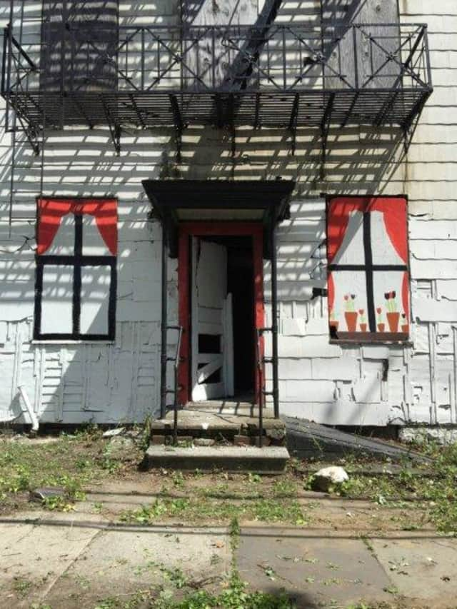 """Abandoned, or """"zombie,"""" houses not only bring property values down, they can be dangerous, say local officials. Mount Vernon, which is targeting about 40 of these homes sprinkled throughout the city, razed one recently that, it said, was hazardous."""