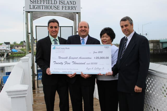 The big check is presented on the dock! See story for IDs.