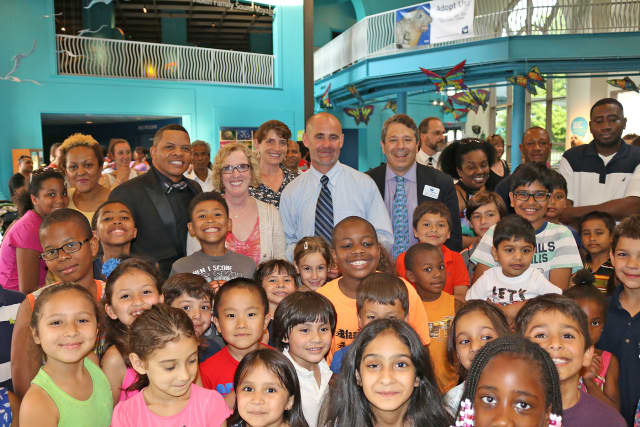 Sandy Bria, of GE Capital, and John Reynolds, principal of Jefferson Science Magnet School, were the recipients of the Maritime Aquarium at Norwalk's 2015 Seal of Approval Awards.