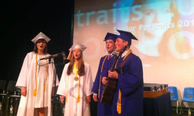 A group of graduates prepare their song before the Darien High School graduation ceremonies in 2015.