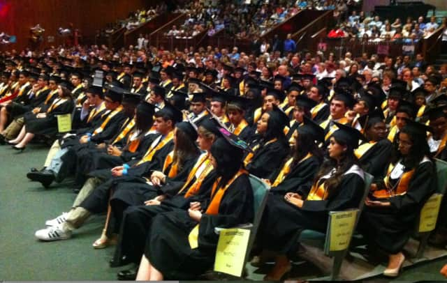 Students at the Academy of Information Technology & Engineering sit during the school's graduation ceremony in 2015.