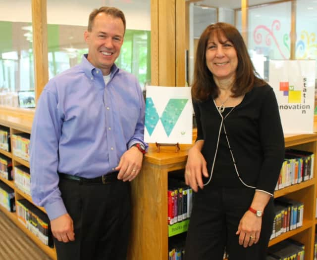 """Peter Verrilli, principal of be3 Marketing Group, left, and Robin Axness, director of development for Wilton Library, helped create the award-winning """"Path to Innovation,"""" which was honored at this year's Connecticut Publicity Awards program."""