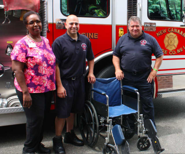 Waveny LifeCare Network recently donated a wheelchair for New Canaan firefighters to use for training purposes. Yolette Milford, left, a Waveny rehab assistant, presented the gift to the New Canaan Fire Department.