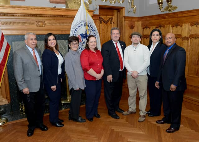 Grace Borrani, pictured second from left, along with other members of the Hispanic Advisory Board and Mayor Mike Spano (fifth from left).