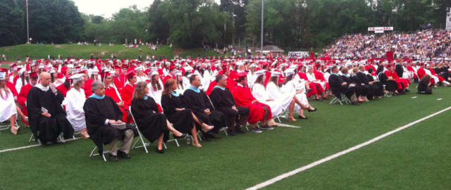 The graduation ceremony begins at Greenwich High School.