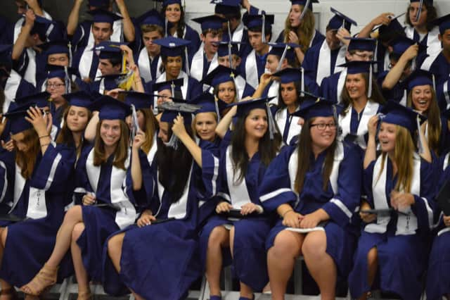 The students are turning their tassels as the graduation becomes official.