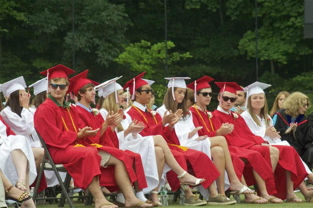 New Canaan High School holds 2015 commencement ceremonies Thursday evening, graduating 320 seniors.