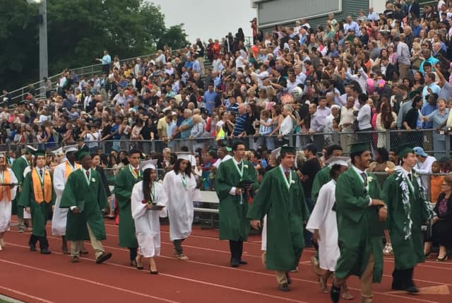 The Norwalk High School Class of 2015 walks off the field to thunderous applause from the audience after graduating. This year's graduation occurs June 14.