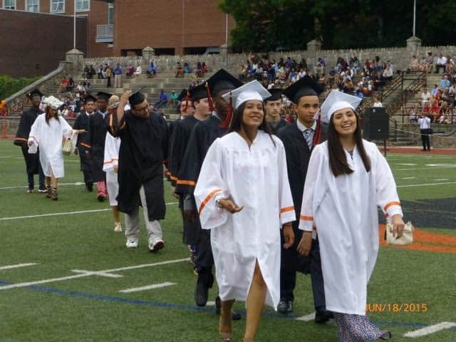 Stamford High School graduates hit the field during commencement exercises at Boyle Stadium in 2015. Connecticut officials announced this week that the state's graduation rates hit a record high of 87.2 percent that year.