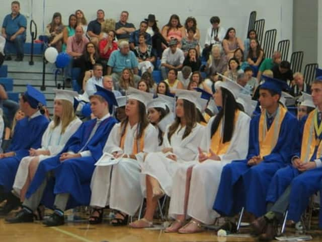 Some of the Class of 2015 graduates at Dobbs Ferry High School listening to Sasha Clarick's valedictorian speech on Saturday evening.