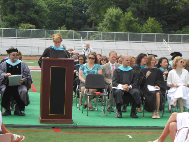 Principal of Rye High School, Patricia Taylor addresses the Class of 2015.  On Friday, Taylor confirmed the tragic death of a Rye High graduate of the Class of 2014..