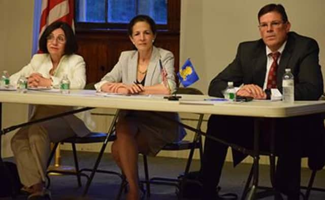 State Sen. Toni Boucher, State Reps. Gail Lavielle and Tom O'Dea, field questions at the town hall meeting.