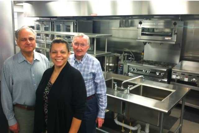 John Gutman, Betsy Lopez and Mike Boyd stand in the kitchen of New Covenant House's new site at 174 Richmond Hill Ave.
