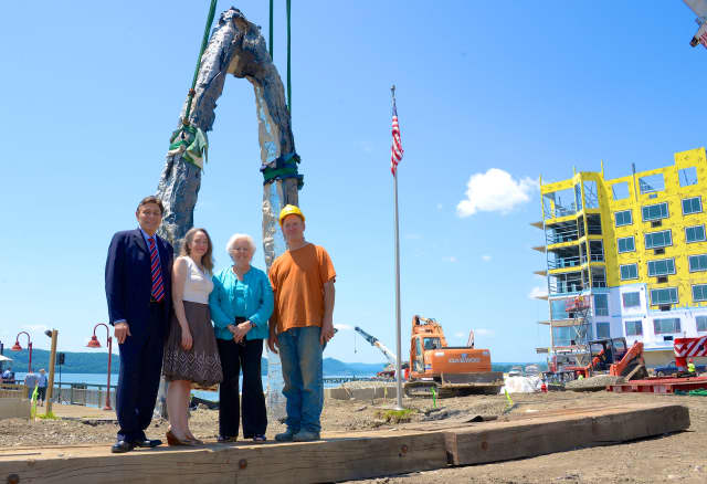 A sculpture, created by Peter Lundberg, was raised Monday at the new public waterfront park and promenade being built at Harbor Square.