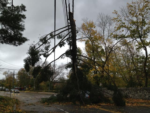 Multiple roads in Redding are blocked by fallen trees and wires.