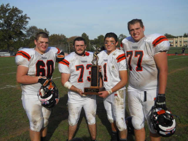 Mamaroneck captains (from left) Peter Harris, Kevin Droesch, Rob Nigro and Tyler Kruse lead the Tigers into their Section 1 Class AA Football Championship semifinal against North Rockland Saturday.