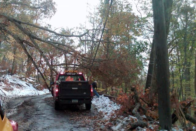 Workers cope with downed trees on Chapel Road in the wake of 2011's October snowstorm.