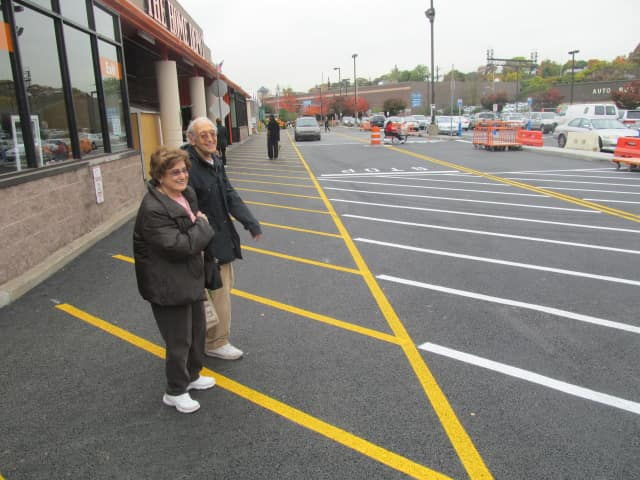 Mamaroneck residents Naomi and Max Eagelfeld stock up before  Hurricane  Sandy on Friday at the New Rochelle Home Depot.