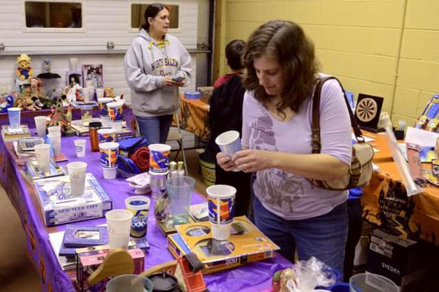 Residents peruse items at the first annual Croton Falls Fire Department Ladies Auxiliary penny social.