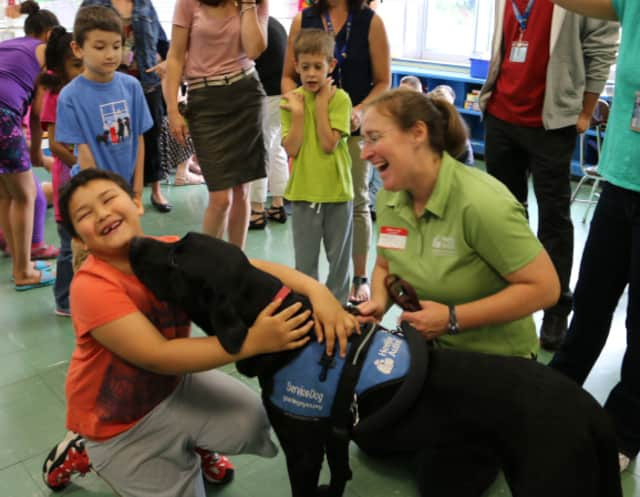 A representative from Guiding Eyes brought one of its autism dogs to discuss autism with the fifth-grade students at Thomas Jefferson Elementary School.