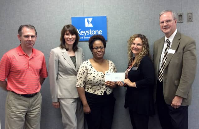 """From left, Keystone House's Barry McGovern, Valerie S. Williams and Marsha Placide with the $5,000 grant given by First County Bank's Elona Needle and David Van Buskirk toward the Norwalk organization's """"Home Sweet Home"""" initiative."""