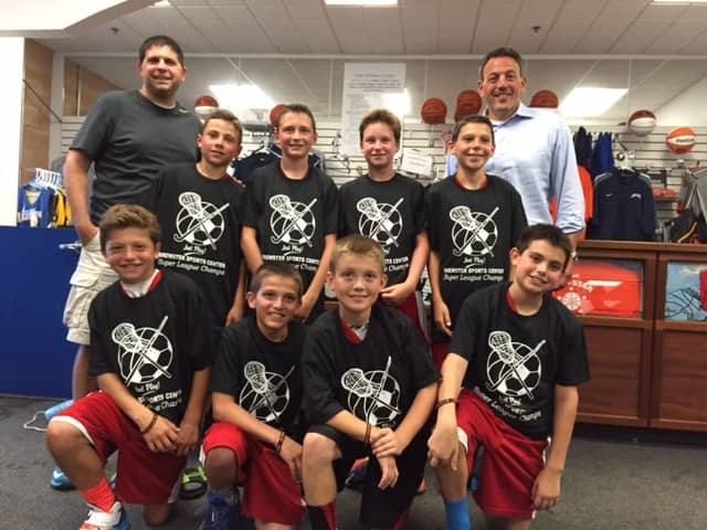 Somers Fifth Grade Boys won the Brewster Super League A title. Bottom row from left Derek Marcus, Nicky Iocovello, T.J Olifiers, Nick Ferraro. Top row from left Bennett Leitner, Ryan Grant, Max Hechler, Jake Riina. CoachMike Ferraro, Kevin Marcus