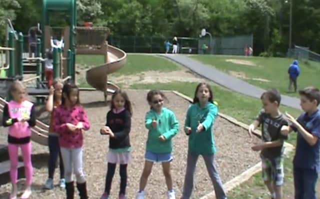 """Croton-Harmon Carrie E. Tompkins Elementary School students in  the Signing with a Friend Club learned how to sign Pharrell William's song """"Happy."""""""