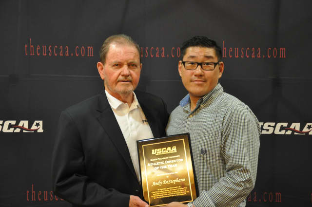 Bill Casto, left, executive director, United States Collegiate Athletic Association, presents Andy DeStephano, Berkeley College Director of Athletics, with the USCAA Athletic Director of the Year award.