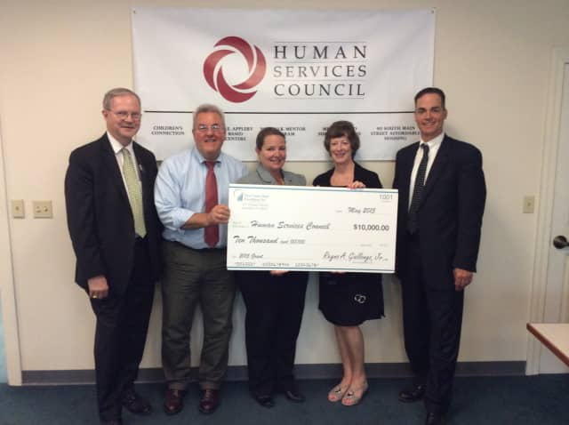 First County Bank's David Van Buskirk, AVP and business development officer, and Wendy Macedo, AVP and branch manager presented a check for $10,000 to the Human Services Council in support of the Norwalk Mentor Program.