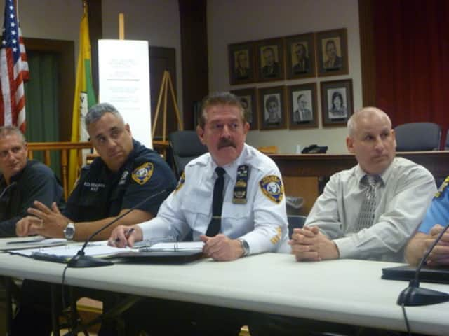 Yorktown Police Chief Daniel McMahon, center, announced a State of Emergency to allow for emergency crews to prepare for Hurricane Sandy.