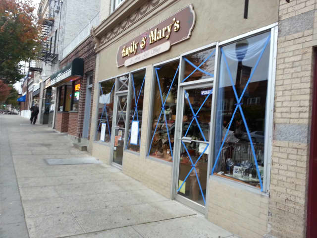 Mamaroneck stores taped up windows in preparation for Hurricane Sandy.