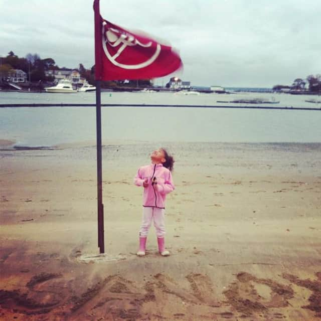A young resident stands on the sand at Harbor Island Park in Mamaroneck at 5 p.m. on Sunday with Hurricane Sandy less than a day from hitting land.