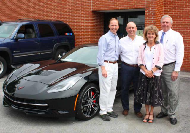 From left, Steve Karl, vice president of Karl Chevrolet; John Polera; Joanne Boyer, director of development for Waveny LifeCare Network; and Jim Darling, senior vice president of First County Bank.
