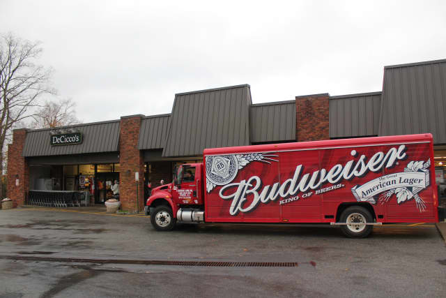 A beer truck arrives with an early morning shipment at DeCicco's in Cross River.