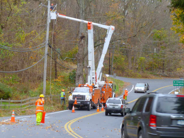 NYSEG crews repair a downed power line