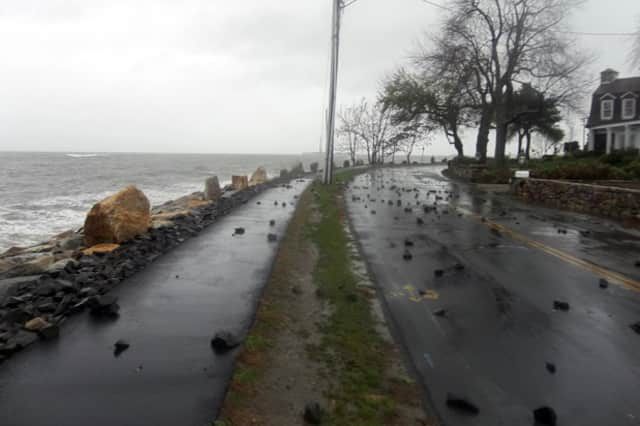Debris covers a roadway near Compo Beach in Westport following flooding from a past storm.