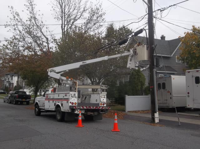 Con Edison workers are busy at work fixing power lines.