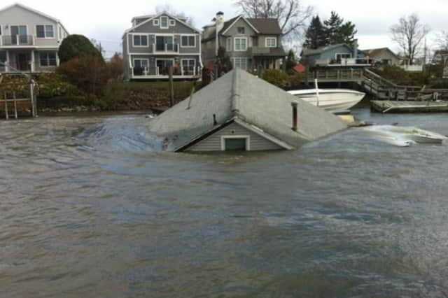 A Fairfield Beach Road home is submerged by flooding after Hurricane Sandy.