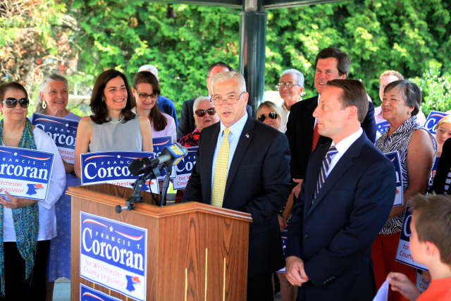 Bedford Councilman Francis Corcoran announces his candidacy for a Westchester County Board of Legislators seat in front of family, friends and Town Board colleagues on Thursday. County Executive Rob Astorino is to the right of the podium.