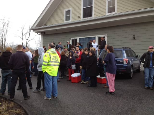 North Salem residents lined up to get dry ice and potable water yesterday. Nearly all of the town was without power Tuesday afternoon.