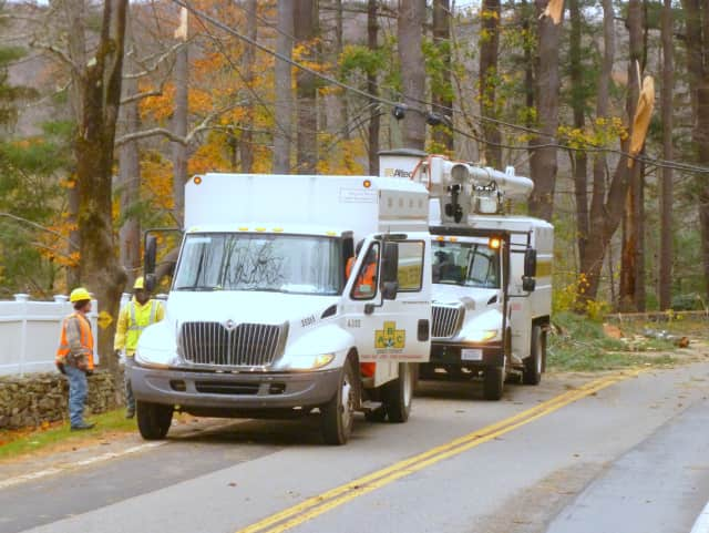 A tree service company works to clear Route 137 (Stone Hill Road) in Pound Ridge on Wednesday afternoon.