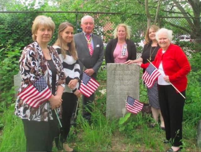 Stamford Daughters of the American Revolution honoring the Revolutionary soldiers are Altheas Tenca, Jessica Tenca, Tom Gorin,from the Capt. Mathew Mead Branch SAR Branch, Katie Sumner, Stamford DAR Regent, Rebecca Boutsikoudis and Justine Goebel.