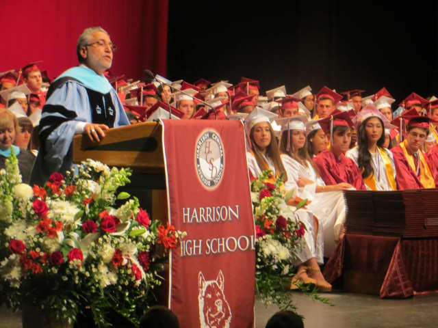Harrison Superintendent Louis N. Wool speaking to high school graduates, family and friends last spring during commencement at SUNY Purchase. On Tuesday, Harrison voters approved the school district's $110 million budget for 2016-17.