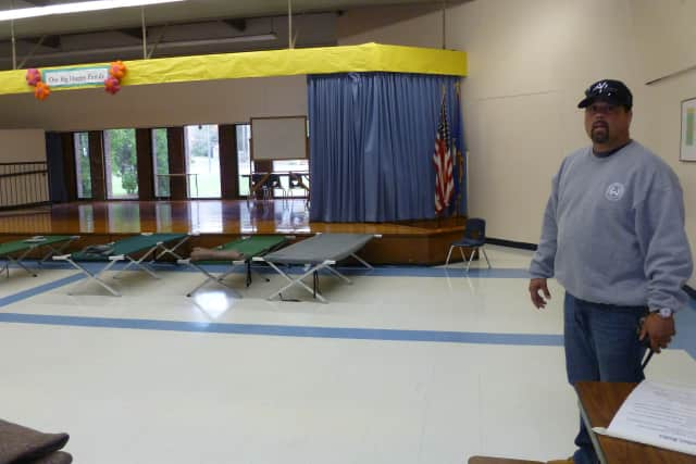 Willie DeHostos, head custodian at Miller-Driscoll School in Wilton, is also helping to run the town's emergency shelter there. The shelter opened in the wake of Hurricane Sandy.