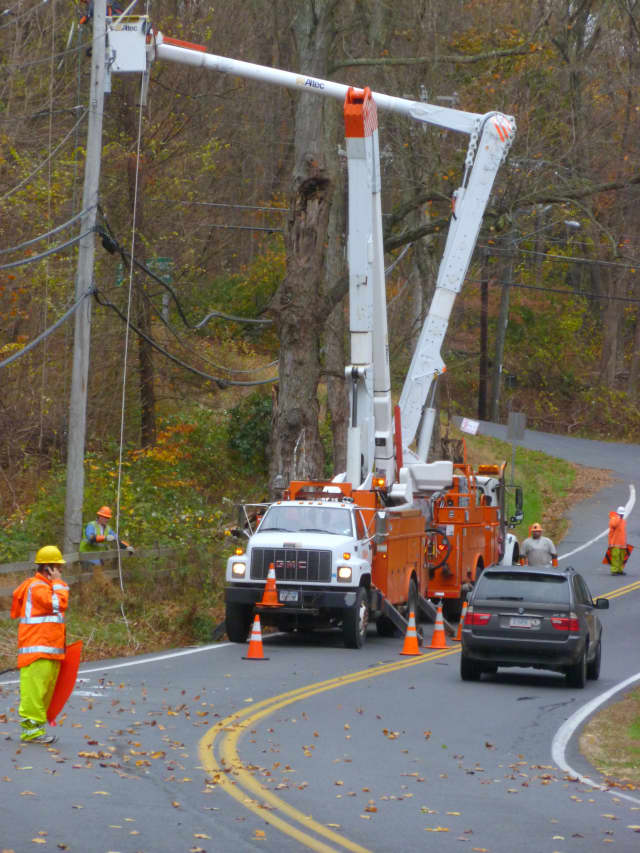 NYSEG works to repair power lines on Westchester Avenue hours before Hurricane Sandy actually arrived Monday. Since then, no power has been restored to the town.