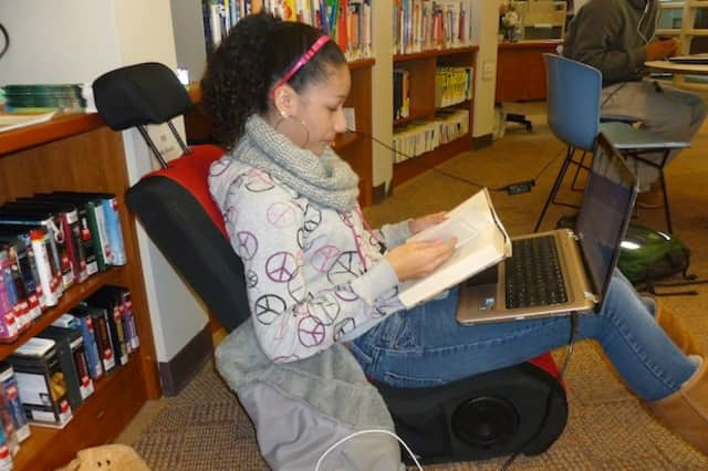 Rachel Blair, a Woodlands High School freshman, has been doing schoolwork at the Greenburgh Public Library. Many school districts closed all week after Hurricane Sandy.